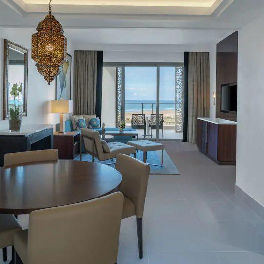 https://agm.oceanx.network/wp-content/uploads/2021/08/tngah-junior-suite-living-room-dining-area-540x540.jpg